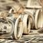 Наличный курс доллара в продаже снизился до 23,91 гривны за доллар